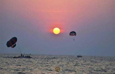 Parasailing-with-sunset-Vagator-Beach